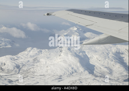 View from plane window over snow covered mountains in Tromso, Norway