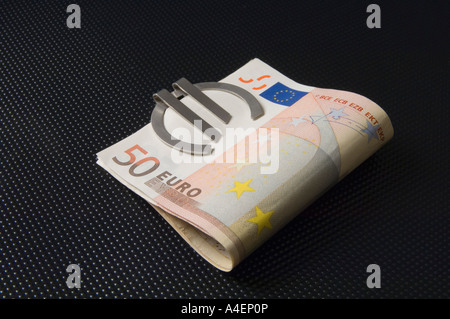 A Money Clip In The Form Of A Euro Symbol Holding 50 Euro Banknotes