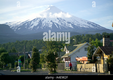 Pucon overlooked by the snow capped cone of Villarrica Volcano La Araucania Lake District Chile - Stock Photo