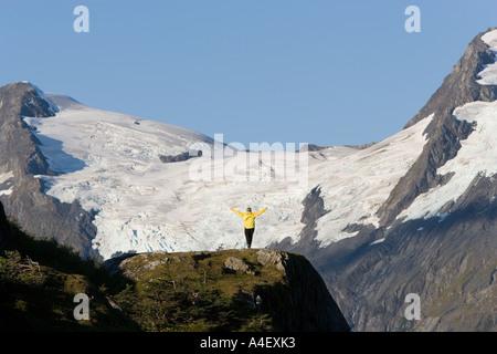 alaska woman hiker on alpine terrain near portage pass glacier in background - Stock Photo