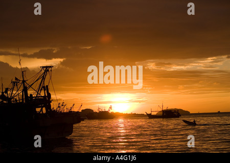 Malaysia Borneo Sabah Kota Kinabalu South China seafront fishing boats sunset - Stock Photo