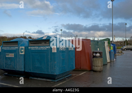 recycling bins in a supermarket car park in cornwall,england - Stock Photo