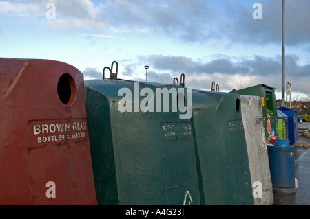 glass bottle recycling bins in a supermarket car park in cornwall,england - Stock Photo