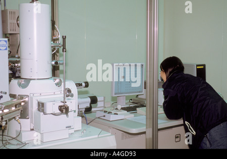 Researcher With Field Emission Scanning Electron Microscope at Nano Technology Research Center Hsinchu Taiwan - Stock Photo