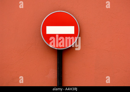 Traffic sign No Entry in front of red wall - Stock Photo