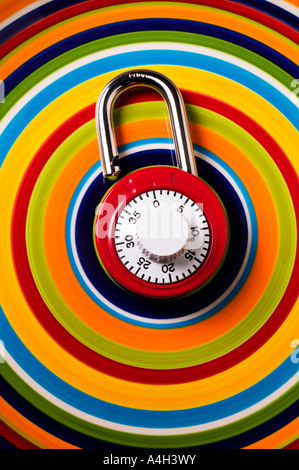 Combination lock on plate with repeating circles - Stock Photo