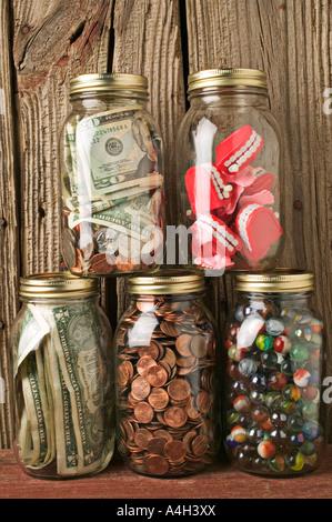 Jars full of money and teeth - Stock Photo