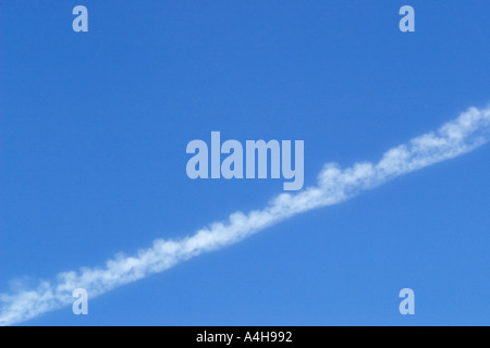 aging vapor trail - Stock Photo
