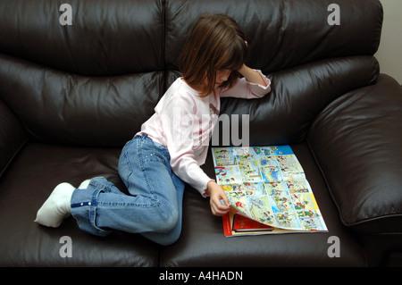 Comic, girl reading comic, comics - Stock Photo