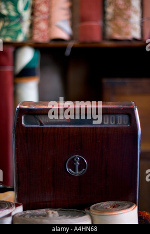 Old fifties cash register in a fabric shop - Stock Photo