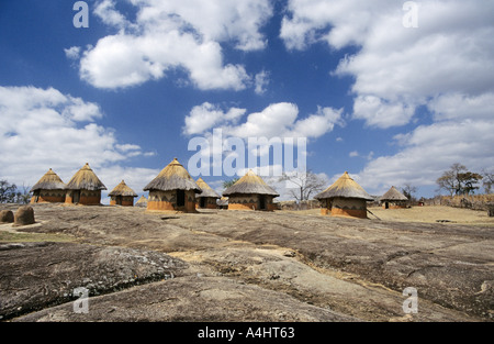 African mud huts thatched with straw Shona village recreation Zimbabwe Africa - Stock Photo