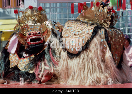 Barong Dancers from Indonesia dancing a Traditional Indonesian Lion Dance Performance on Stage - Stock Photo
