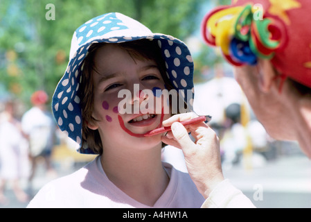 Painting the Face of a Young Person in British Columbia Canada - Stock Photo
