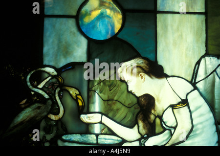 Louis Comfort Tiffany stained glass window art work 'woman with flamingos' - Stock Photo