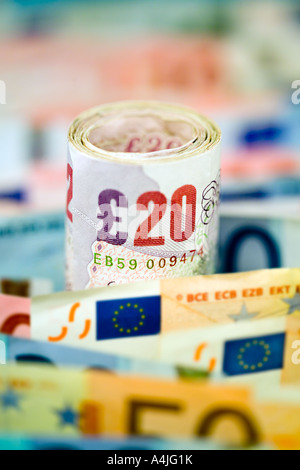 European 50 20 10 5 euro Bank Notes and roll 20 pounds - Stock Photo