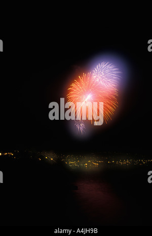 Fireworks over coastline Laguna Beach California USA - Stock Photo
