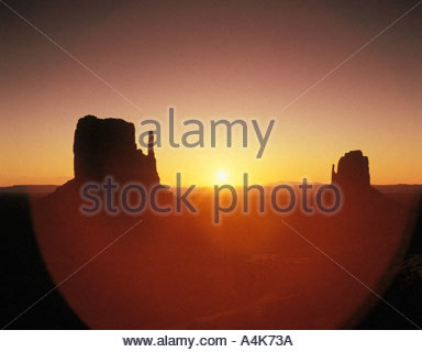 Sunrise behind the Mittens buttes Monument Valley Navajo Tribal Park Arizona USA - Stock Photo