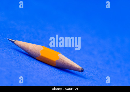 A pencil wearing out on both ends - Stock Photo