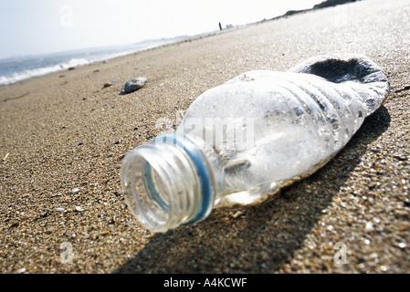 Plastic bottle on beach - Stock Photo