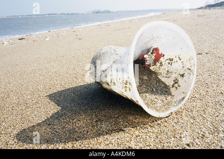 Plastic cup on beach - Stock Photo