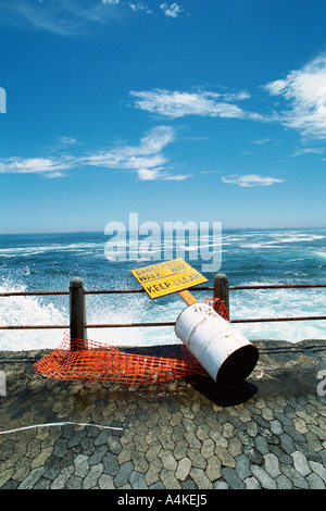 Pier with fallen warning sign - Stock Photo