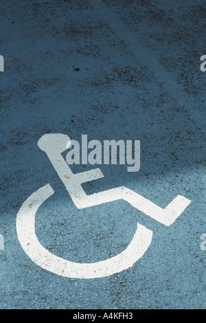 Handicap sign on asphalt - Stock Photo