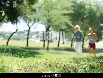 Mature couple jogging - Stock Photo