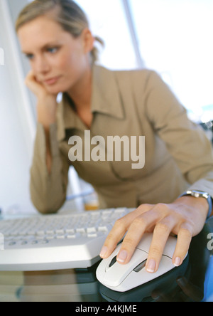 Young woman using computer - Stock Photo