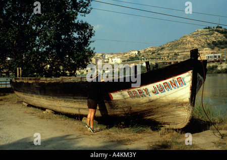 Traditional llauts or bbarges on the Ebro river in catalunya Catalonia Spain - Stock Photo