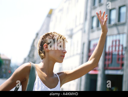 Woman with hand up, outside - Stock Photo