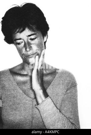 Woman frowning, portrait, b&w.