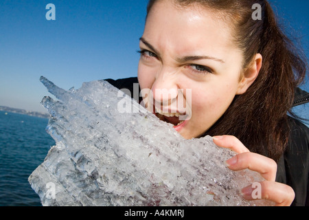Young woman in the quay harbor of Geneva lake going to eat ice - Stock Photo