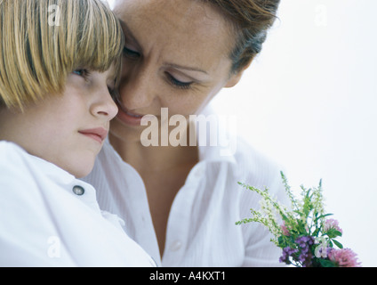 Mother and son with bouquet of wildflowers - Stock Photo