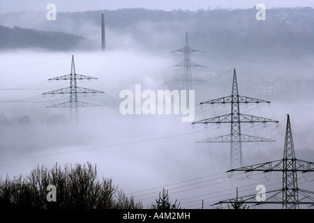 DEU Germany Bochum High Voltage electrical power lines between Essen Bochum morning fog - Stock Photo
