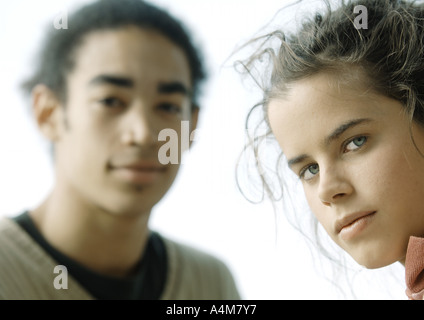 Young couple, looking at camera, close-up - Stock Photo