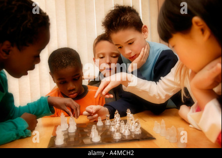Group of boys playing Chess - Stock Photo