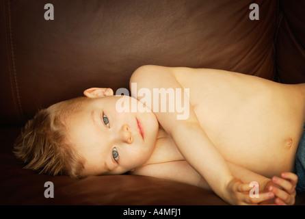 Young boy lying down - Stock Photo
