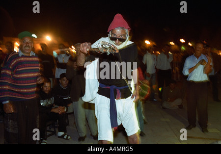 MARRAKECH MOROCCO AFRICA  Entertainers at Djemaa el Fna square at night performing Berber comedy drama - Stock Photo