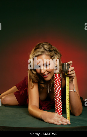 Size matters to a casino girl! - Stock Photo