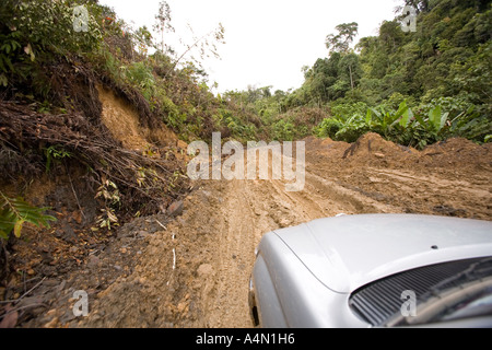 Malaysia Borneo Sarawak Belaga 4WD vehicle driving along muddy logging track - Stock Photo