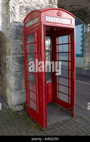 old style red telephone box with missing door in Carnlough county antrim - Stock Photo
