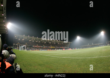 photographers and pitch side looking towards South Stand in floodlights during International Friendly windsor park - Stock Photo