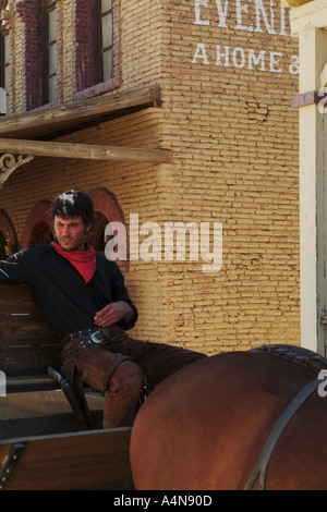 man sitting on a horse drawn carriage at wild west film set in Andalusia Spain - Stock Photo
