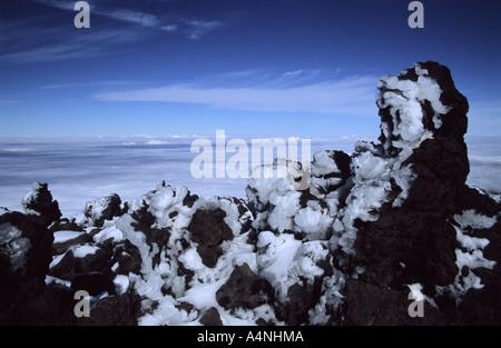 Ice covered lava rocks at Pico del Teide mount Teide National Park Tenerife Canary Islands Spain - Stock Photo