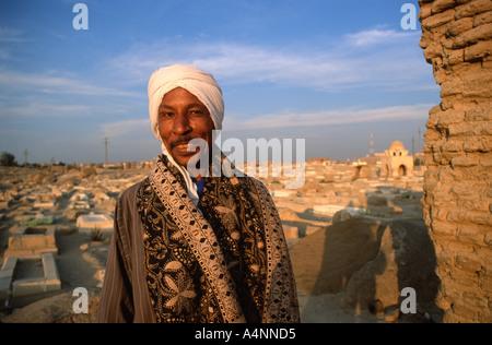 Nubian guard Islamic Fatimid Cemetery in Aswan Egypt - Stock Photo