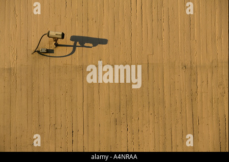 A CCTV camera fixed to an outdoor cement wall April 2005 USA - Stock Photo