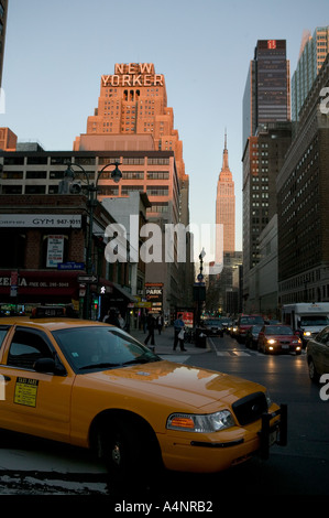 New Yorker Hotel art deco building on Eighth Avenue in Midtown New York USA April 2005 with Empire State behind - Stock Photo