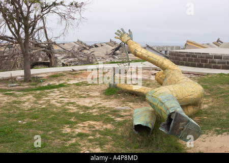 Golden Fisherman statue lies on ground six months after Hurricane Katrina in Biloxi Mississippi USA - Stock Photo