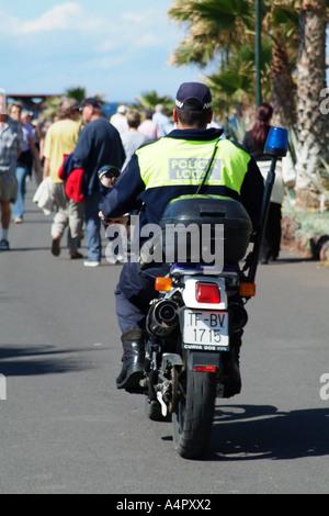 Police motorcycle patrol on the promenade at Playa de Las Americas southern Tenerife Canary Islands Spain - Stock Photo