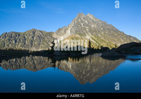 Mount Stuart reflected in still water of Ingalls Lake Central Cascades Washington USA - Stock Photo